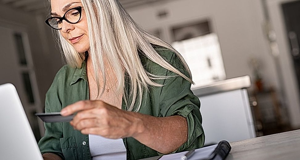 blonde woman doing online payment